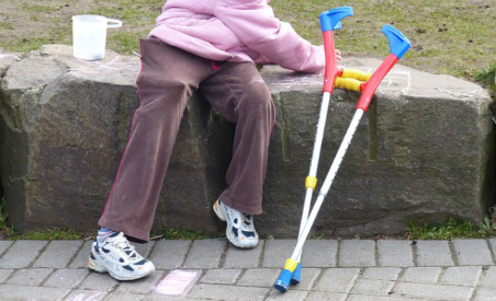 Older person with walk assists 452x275